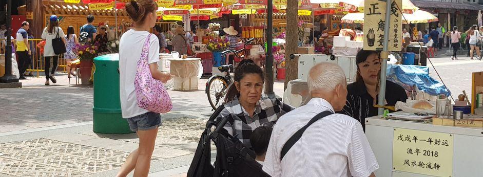 Singaporean people eat at a restaurant